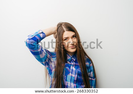 Pretty Confused woman puts her hand on the head, isolated on white - stock photo