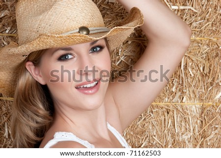 Pretty country girl wearing hat - stock photo