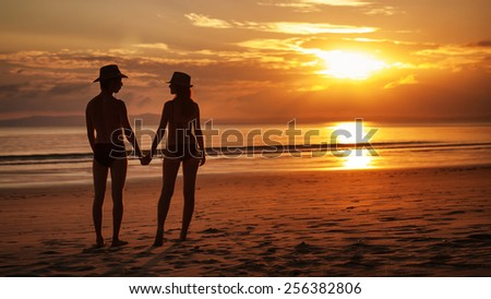 Pretty couple is standing on the tropical sunset background, Havelock, Andaman Islands - stock photo