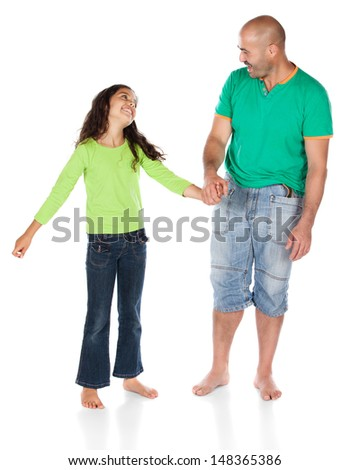 Pretty cute caucasian girl wearing a green long sleeve top and blue jeans is holding the hand of her father.