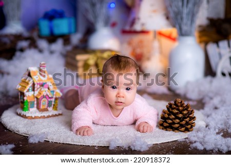 pretty cute child in a New Year's suit near a Christmas tree. blue accent decor - stock photo
