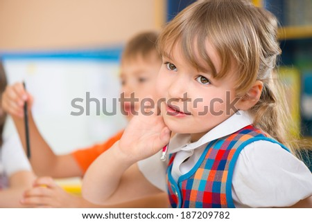 Pretty cute little girl portrait at daycare - stock photo