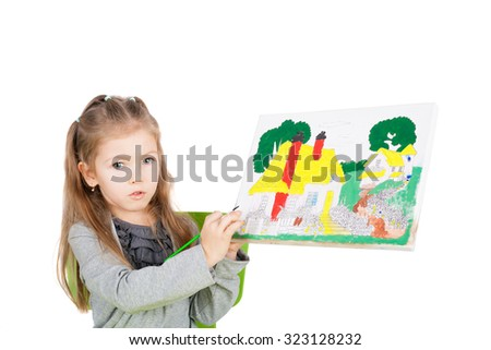 pretty cute little girl showing her painting - stock photo