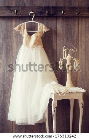 Pretty dress and table with pearl jewellery - vintage tone effect - stock photo