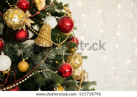 Pretty dressed up Christmas tree close-up. Background for holiday