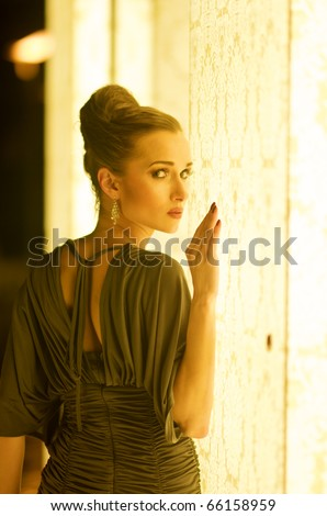 Pretty Elegant and stylish model looking back outdoor - stock photo