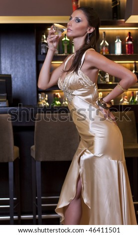 pretty elegant woman drinking a coktail cup