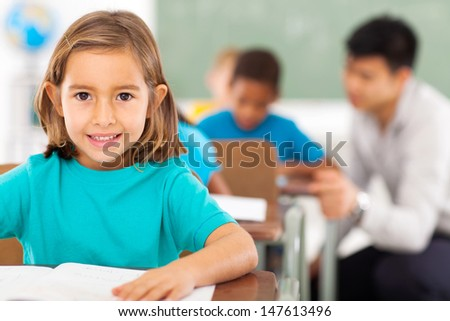 pretty elementary school student in classroom - stock photo
