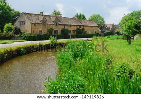 Pretty English village of Lower Slaughter in the Cotswolds - stock photo