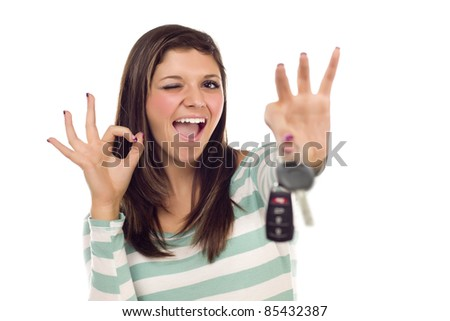 Pretty Ethnic Female Winking with New Car Keys and Okay Sign Isolated on a White Background. - stock photo