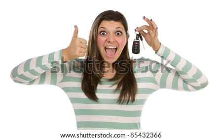 Pretty Ethnic Female with New Car Keys and Thumbs Up Isolated on a White Background. - stock photo