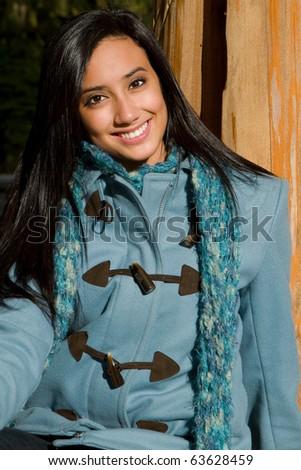 Pretty ethnic girl smiling - stock photo