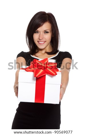 pretty excited woman happy smile hold gift box in hands, isolated over white background - stock photo