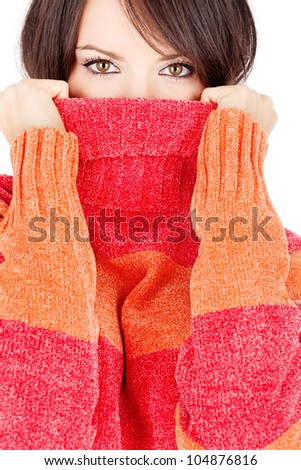 pretty eyes of a brunette woman in wool sweater, isolated on white background - stock photo