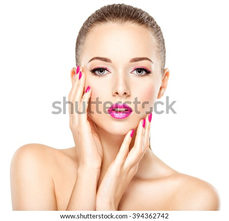 Pretty face of a beautiful  girl with pink eye makeup and bright pink  nails. Fashion model posing on white background