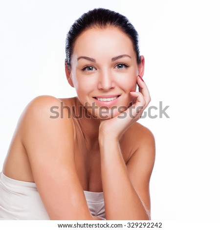 Pretty face of beautiful smiling woman - posing at studio isolated - stock photo