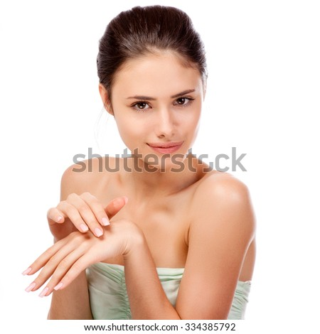 Pretty face of beautiful smiling woman - posing at studio isolated on white. - stock photo
