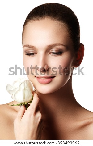 Pretty face of beautiful young woman with rose on hands - white background. Beauty face of young woman with flower. Beauty treatment concept