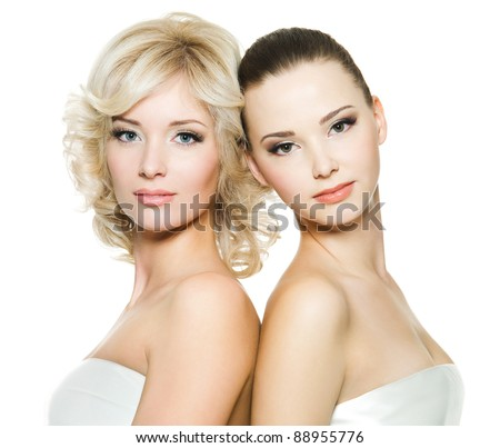 Pretty faces of the beautiful sexy young adult women posing on white background - stock photo