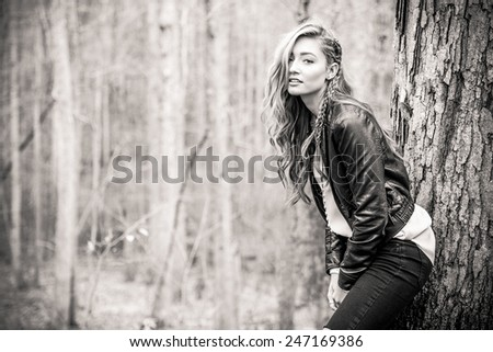 Pretty fashion girl wearing leather jacket outdoors - stock photo