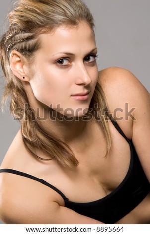 Pretty fashion woman in bikini portrait over a grey background - stock photo