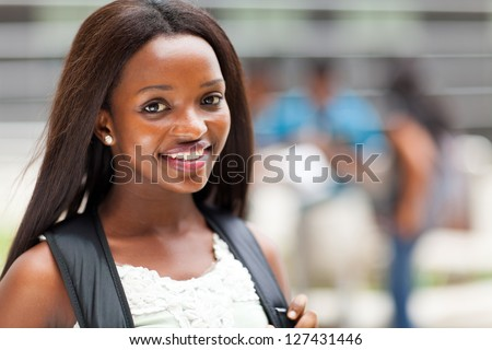 pretty female african american high school student on campus - stock photo