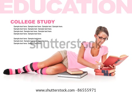 Pretty Female College Student Studying with text space above - stock photo