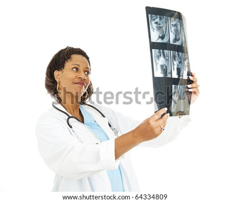 Pretty female doctor checking out a patient's CT scan. - stock photo