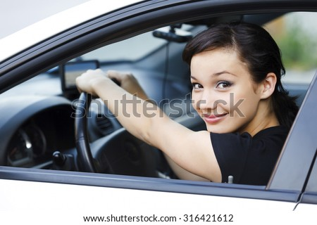 Pretty female driver - stock photo