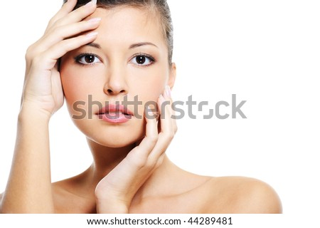 Pretty female face of a beauty asian over white background - stock photo