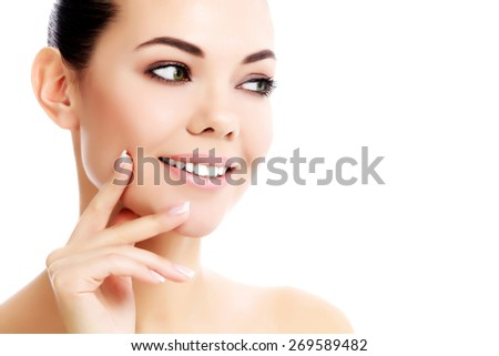 Pretty female looking at something against a white background  - stock photo