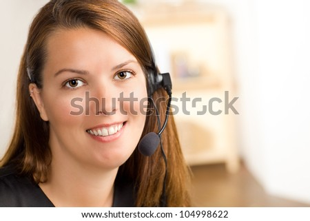 Pretty female operator ready to take your call