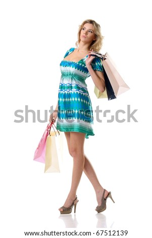pretty female standing with shopping bags and not looking in camera