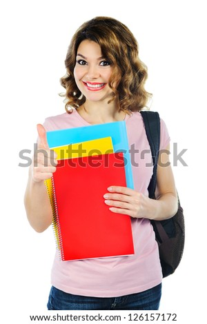 Pretty female student with colorful notebooks isolated on white
