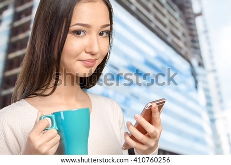 pretty female teenager using smartphone  - stock photo