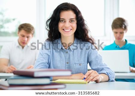 Pretty female university student portrait - stock photo