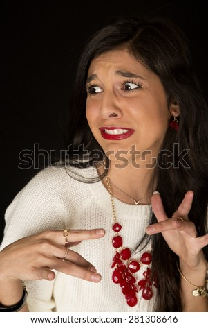 Pretty female with a scared startled expression - stock photo
