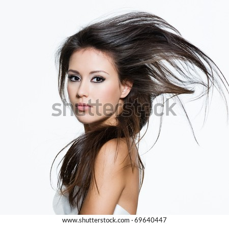 Pretty female with beautiful long brown hairs, posing isolated on white - stock photo