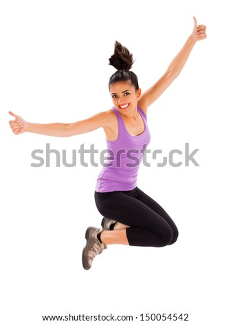 Pretty fit girl showing like sign while jumping high.