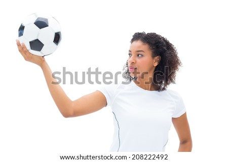 Pretty football fan in white holding ball on white background