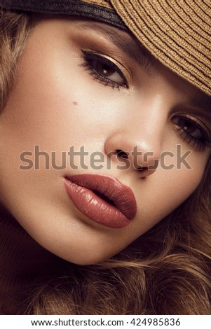Pretty fresh girl, image of modern Twiggy in fashionable brown hat, with unusual eyelashes and curls.