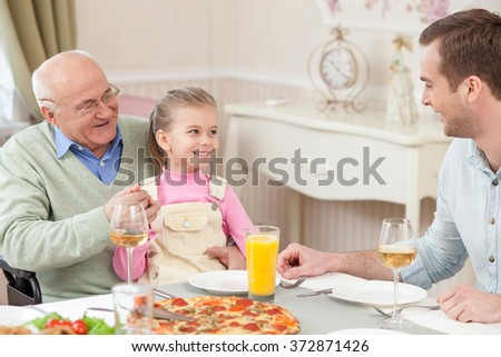 Pretty friendly family has a dinner with joy - stock photo