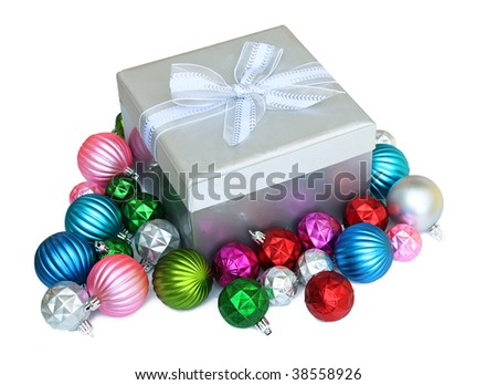 Pretty gift box surrounded by Christmas ornaments