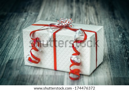 Pretty giftbox with red ribbons - stock photo