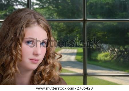 Pretty girl by window - stock photo