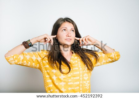 pretty girl can not hear anything, studio photo, isolated - stock photo