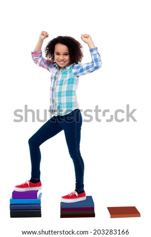 Pretty girl child moving up in school grades - stock photo