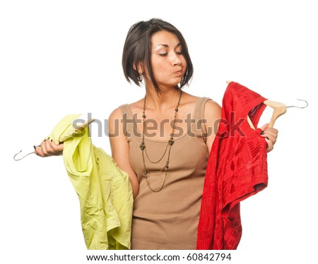 Pretty girl chooses between two dresses - stock photo