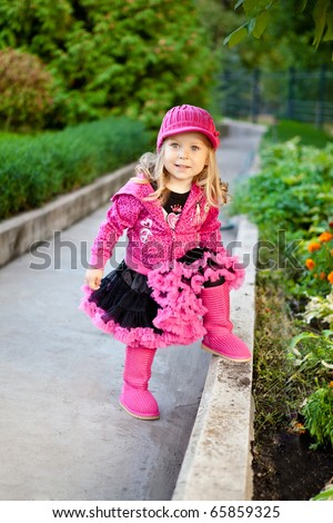 Pretty girl dressed in pink clothes - stock photo