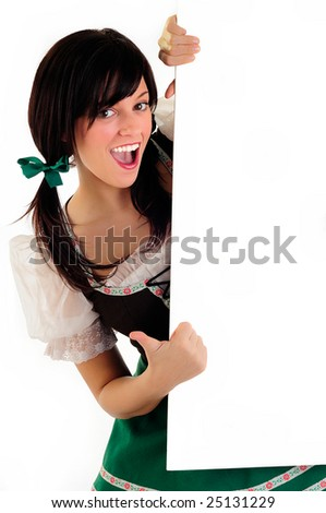 Pretty Girl Dressed In Traditional Costume For St Patrick's Day And Oktoberfest Pointing To Your Message - stock photo